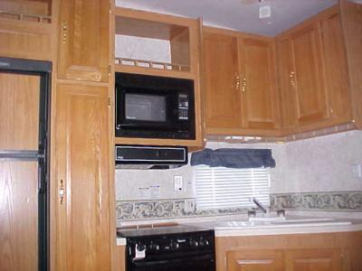 Kitchen and cabinets the kitchen has lots of storage the tall thin